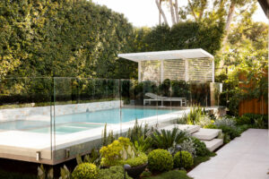 Maroubra secluded gem - Garden design - floating pool - white pergola - stone wall cladding - native plant palette - privacy hedging